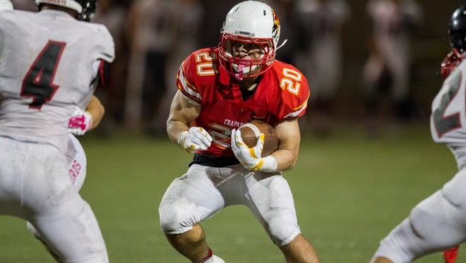 Chaparral's Kurt Shughart rushes against Liberty in the fourth quarter at Chaparral High School on Thursday, Oct. 15, 2015, in Scottsdale. Chaparral won, 42-27.