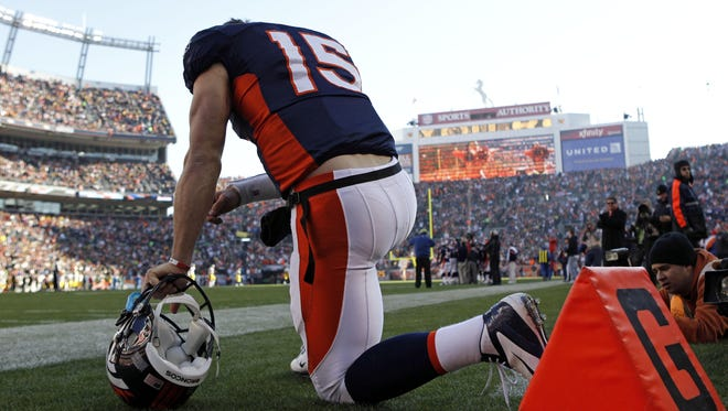 Denver Broncos quarterback Tim Tebow  kneels in prayer before the start  of game against the Pittsburgh Steelers in 2011.   Now Tebow is considering a career in professional baseball.