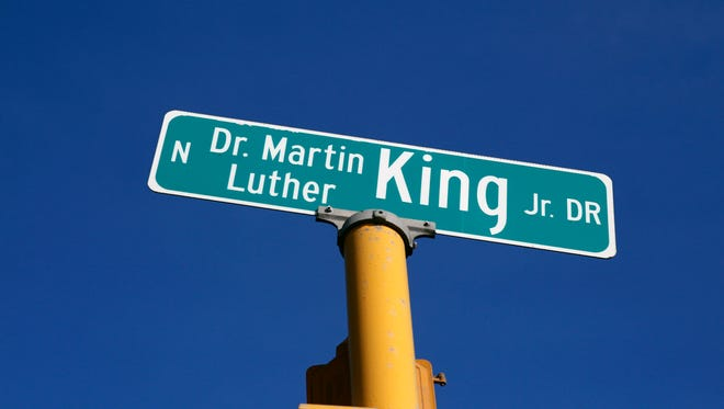 Mayor Henry Maier signed a resolution changing part of N. 3rd St. to Dr. Martin Luther King Jr. Drive in 1984. The 40 King Drive signs cost $2,600.