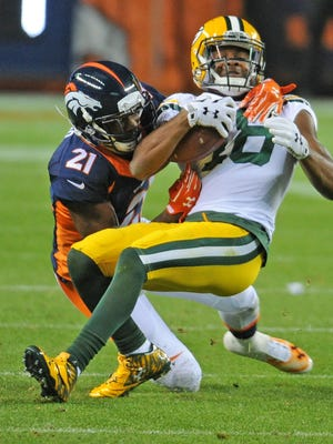 Green Bay Packers wide receiver Randall Cobb (18) gets tackled after a catch in the second quarter against the Denver Broncos at Sports Authority Field November 1, 2015.