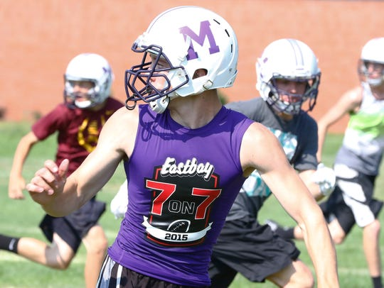 Mosinee's football team works on drill during Tuesday