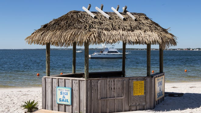 Boat rental kiosks and locations at Navarre Beach. Caterpillars can damage thatch.