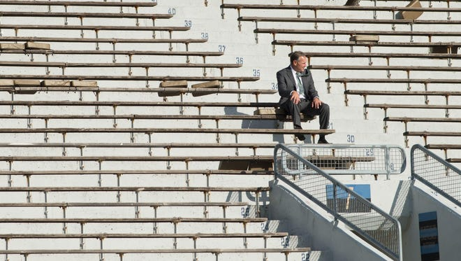 MSU football coach Mark Dantonio sits alone in the stands at Notre Dame Stadium before the Spartans' game against the Irish. Times were better then. Since the Spartans have dropped two straight.