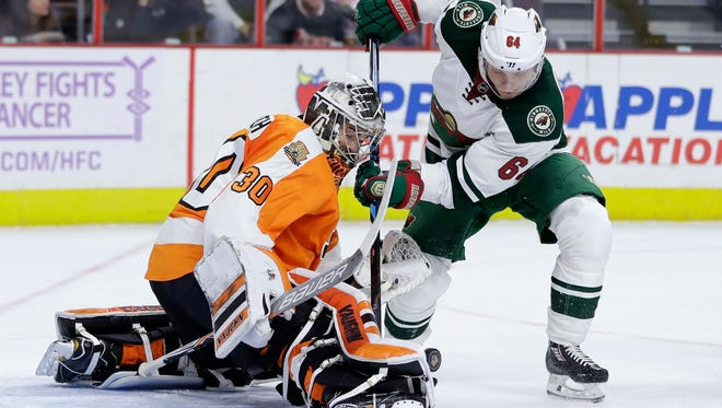 Michal Neuvirth got hurt stopping this shot by Mikael Granlund in the first period Saturday.