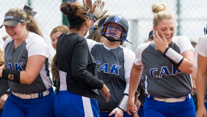CAK's Sydney Fiester (23) is congratulated on her home run hit during a Class AA softball game against Elizabethton on Thursday, May 25, 2017.