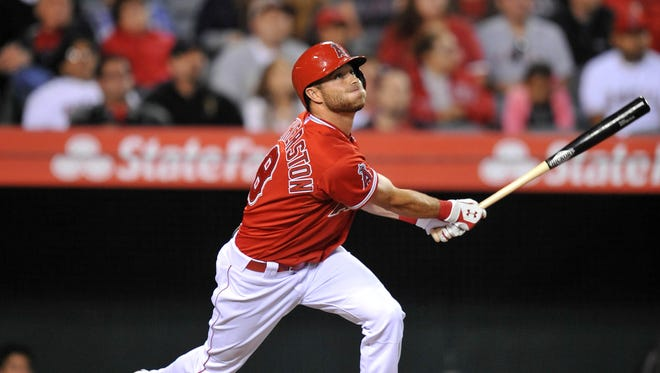 Los Angeles Angels pinch hitter Taylor Featherston (8) hits a sacrifice RBI in the seventh inning against the Oakland Athletics  at Angel Stadium of Anaheim.