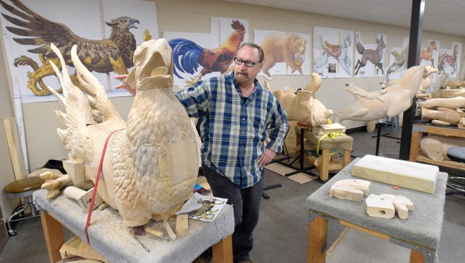 Designer Kurt Christensen looks over one of the unfinished carousel animals he created in the carving studio at the Albany Historic Carousel & Museum in Albany.