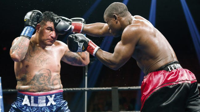 Fred Kassi connects to the forehead of Chris Arreola in their heavyweight bout in July 2015 at the Don Haskins Center. The fight ended in a draw.