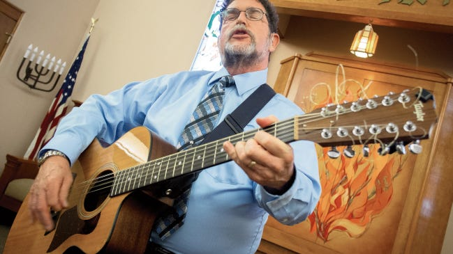 """Rabbi Larry Karol, here singing  at Temple Beth-El, says """"Music has given me extra avenue of expression. I think song sometimes ends up going deeper into a theme."""" The singer-songwriter is reaching a wide online audience with """"House of Prayer,"""" which has special relevance after murders of members of Emanuel AME Church in South Carolina and church bombings in Las Cruces."""