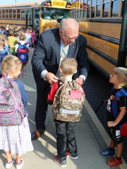 Dr. Kevin Fitzgerald greets kindergarten students at the J. Ralph McIlvaine Early Childhood Center in Magnolia as they got off the bus for their first day of the 2017-2018 school year. The Caesar Rodney School District superintendent has made this an annual ritual.