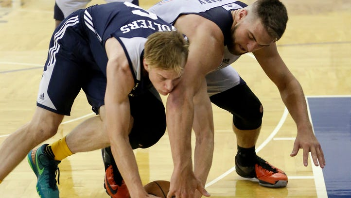 Indiana Pacers' Nate Wolters (6) shoots against Oklahoma City Thunder's Cameron Payne (22) during the first half of an NBA summer league basketball game, Wednesday, July 6, 2016, in Orlando, Fla. (AP Photo/John Raoux)