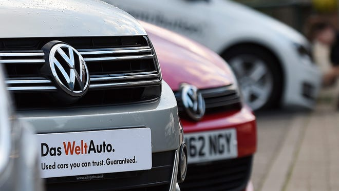 New Volkswagen cars at a dealership in High Wycombe, north west of London Sept. 22, 2015. Chief Executive Martin Winterkorn vowed to get to the bottom of an emissions-cheating scandal and said he intends to keep his job amid mounting pressure on him and Europe's biggest carmaker. Shares in the German carmaker crashed a further 26.2 per cent, wiping billions of euros off the company's market value after it issued a profit warning and admitted that emissions tests for about 11 million cars worldwide might have been manipulated.