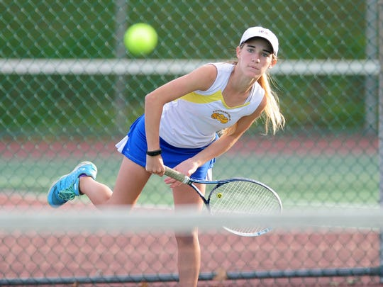 Kennard-Dale's Brianna Miller serves the ball during the doubles championship match against Delone Catholic at South Western High School in Hanover Tuesday, October 11, 2016. Delone Catholic defeated Kennard-Dale to win the championship.