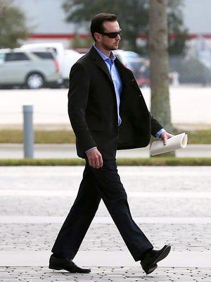 NASCAR Sprint Cup Series driver Kurt Busch leaves his appeal hearing at NASCAR headquarters.