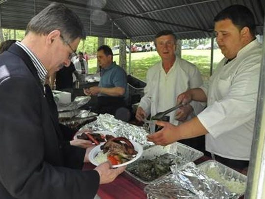 A scene from a past Macedonian Picnic in Cedar Grove.