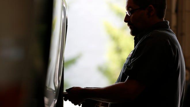 An employee at a Monro Muffler Brake location in Greece.