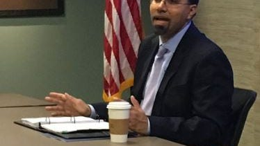 U.S. Secretary of Education, John King Jr. visits with staff and students from Phoenix College in Phoenix, Arizona on Dec. 15