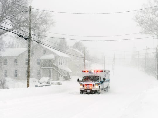 A White Rose ambulance makes its way down East Market Street in Hallam Saturday, Jan. 23, 2016. A snow storm affecting much of the East Coast is expected to bring up to 3 feet of snow to York County, Pa., through Saturday evening.