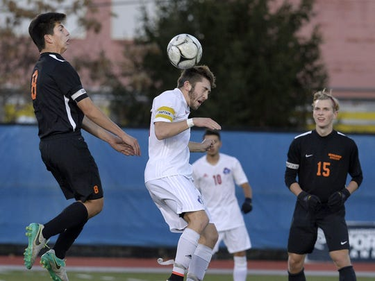 Fairport's Pete Critchlow wins a header in front of Bethlehem's Greg Hyde.