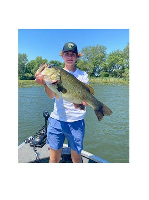 AJ Arneson caught a 5.7 pound, 21.25 inches long Largemouth bass on Sleepy Eye Lake in a virtual fishing tournament put on by the Student Angler Federation in Minnesota. AJ's was the second largest fish caught in the tournament out of 500 registered fishermen or women.