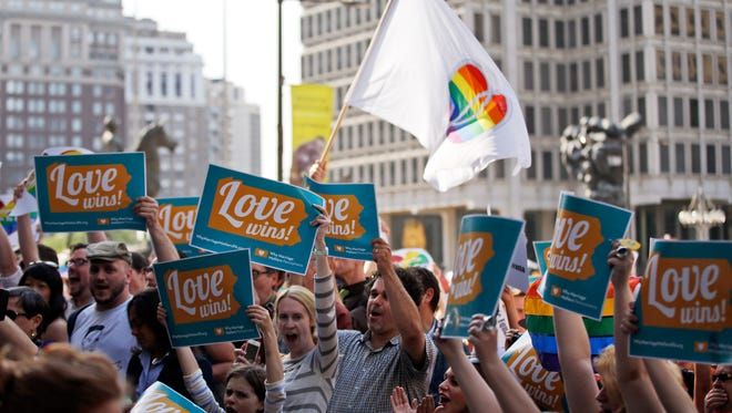 Proponents of same-sex marriage rights rally outside City Hall in Philadelphia after a federal judge struck down Pennsylvania's ban.