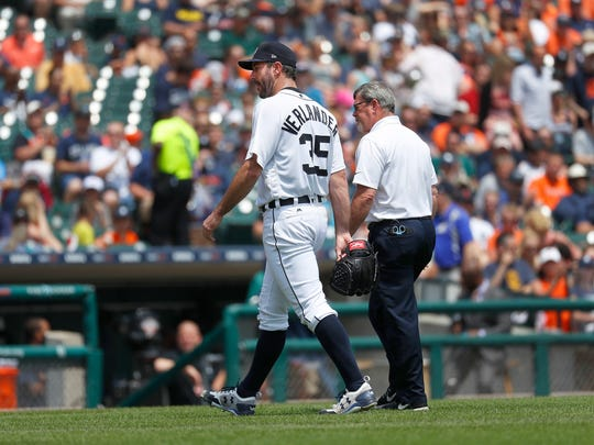 Tigers pitcher Justin Verlander leaves the game with trainer Kevin Rand in the third inning against the White Sox in Detroit, Sunday, June 4, 2017.