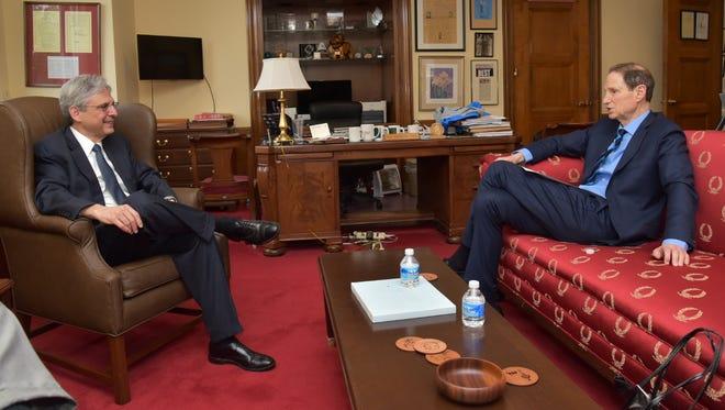 Supreme Court nominee Merrick Garland, left, meets with Sen. Ron Wyden on April 28, 2016 in Washington, D.C.