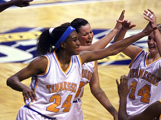"""Tamika Catchings,1997-01: Catchings (24) celebrates with her team mates (33) Kristen """"Ace"""" Clements and (14) Kellie Jolly."""