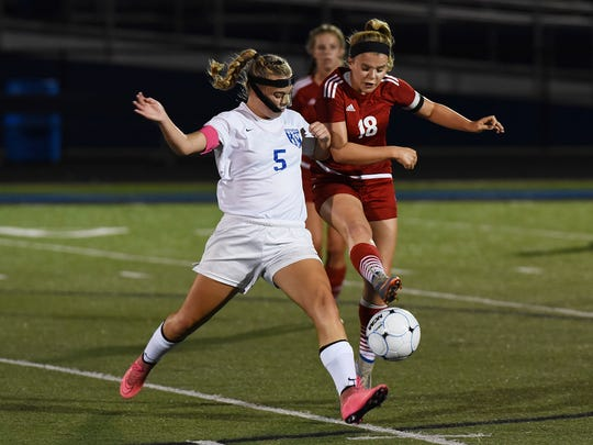 Zanesville's Karissa Weekley (5) and Rosecrans' Chloe Amich battle for the ball during their game last season at John D. Sulsberger Memorial Stadium. Weekley signed with Ohio Dominican on Friday.