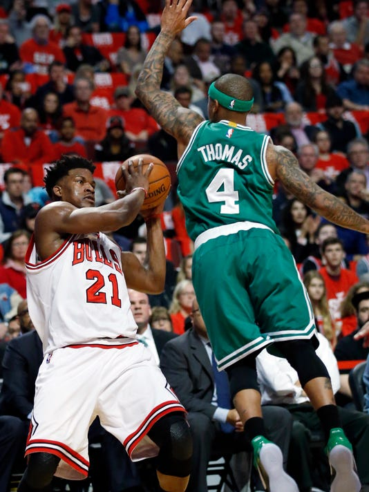 Chicago Bulls' Jimmy Butler, left, looks to pass as Boston Celtics guard Isaiah Thomas defends during the first half in Game 6 of an NBA basketball first-round playoff series, Friday, April. 28, 2017, in Chicago. (AP Photo/Nam Y. Huh)