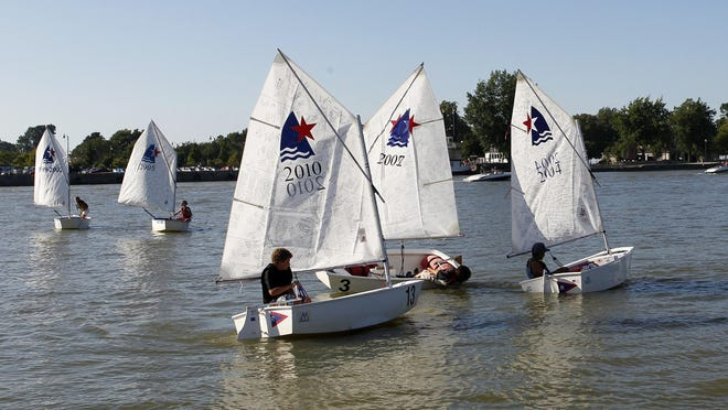 A group of Rochester Yacht Club junior sailors in 2011 move around the Genesee River.