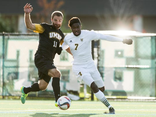 Vermont's Brian Wright (7) battles for the ball with UMBC's Joseph Glos (11) during the men's soccer game between the UMBC Retrievers and the Vermont Catamounts at Virtue Field on Wednesday afternoon October 14, 2015 in Burlington.