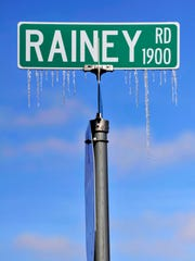 Ice drips from a road sign at an East Lake Road intersection near Lake Fort Phantom Hill Monday. Sunday's freezing drizzle gave way to sunny skies and better roadways to start the New Year in Abilene. Temperatures have been below freezing since 10 a.m. Saturday.