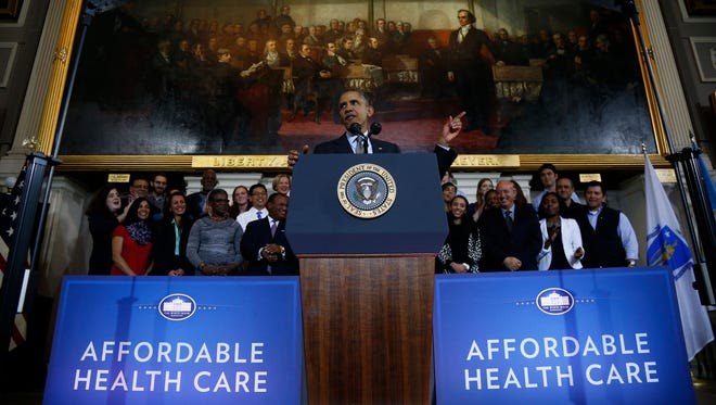 President Obama speaks in Boston about the federal health care law.