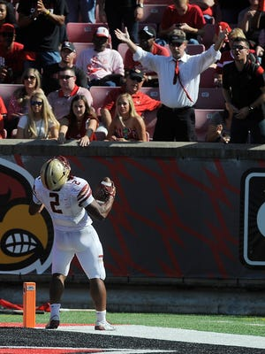 Boston College's AJ Dillon (2) celebrates in front of Louisville fans after scoring against the Cardinals on Saturday at Papa John's Cardinal Stadium. Oct. 14, 2017