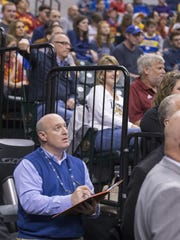 Chris Carr, the Pacers team psychologist, takes notes as he watches the team play Brooklyn on Sunday, April 10, 2016, at Bankers Life Fieldhouse. Indiana beat the Brooklyn Nets 129-105.