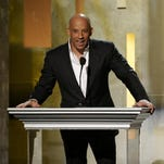 """Vin Diesel speaks on stage at the 45th NAACP Image Awards at the Pasadena Civic Auditorium in February. Diesel will travel to Abu Dhabi in April to film """"Fast & Furious 7."""""""