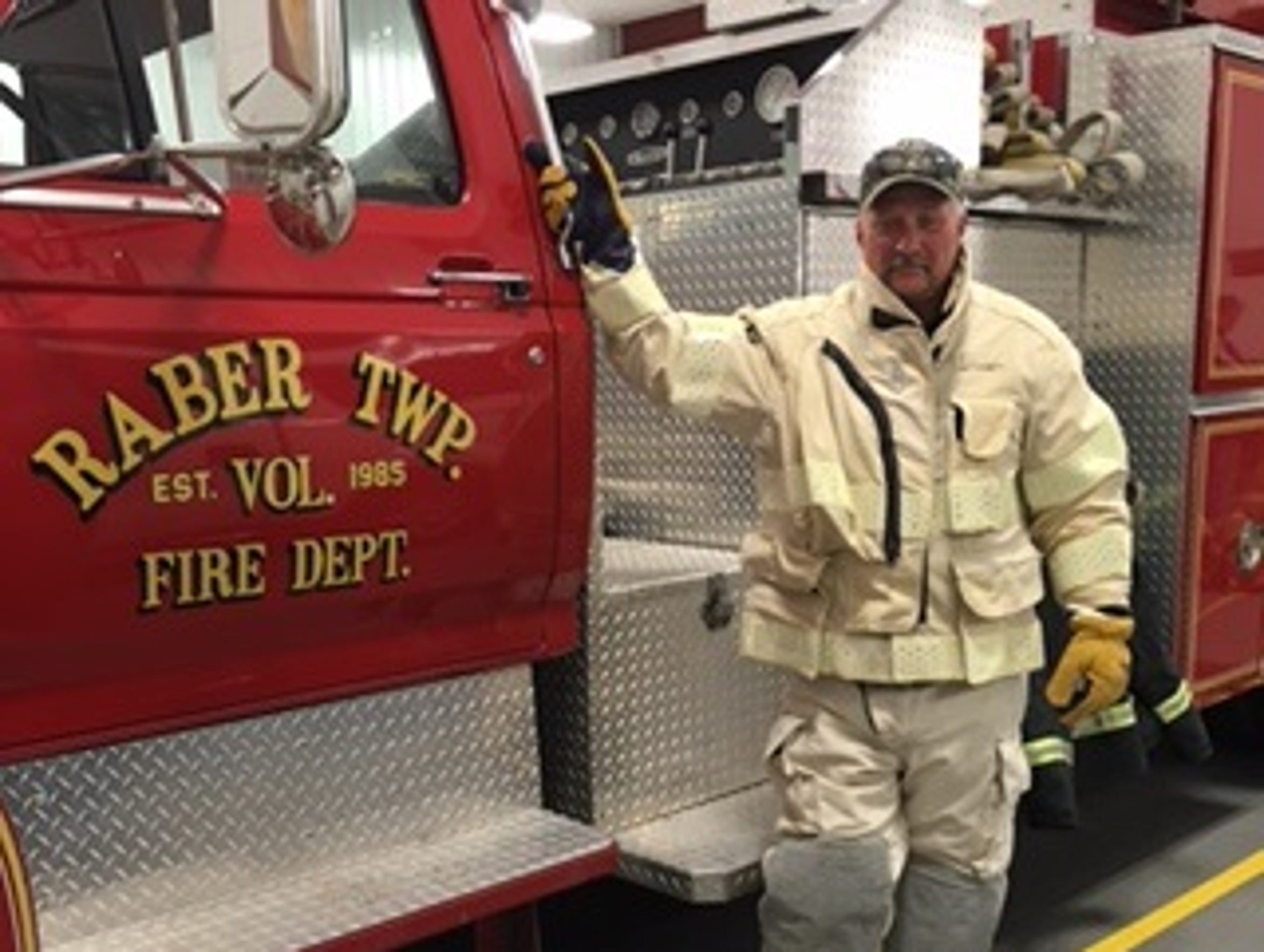 Raber Fire Chief Bruce Johnson tries on a new set of
