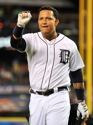 Detroit Tigers' Miguel Cabrera celebrates after his solo home run in the fourth inning as the Tigers take on the Minnesota Twins at Comerica Park in Detroit on Sept. 25, 2014. The Tigers won 4-2.