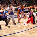 """Brawley """"Cheese"""" Chisholm hits a 4-point shot in a game with the Harlem Globetrotters. The Cherokee grad will host a basketball game at Katz JCC in Cherry Hill in August."""