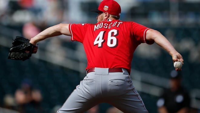 Cincinnati Reds starting pitcher Jon Moscot (46) delivers a pitch in the bottom of the second inning of the MLB Spring Training game between the Cleveland Indians and the Cincinnati Reds at Goodyear Ballpark in Goodyear, Ariz., on Tuesday, March 1, 2016. The Reds took a preseason opening win, 6-5, over Cleveland.