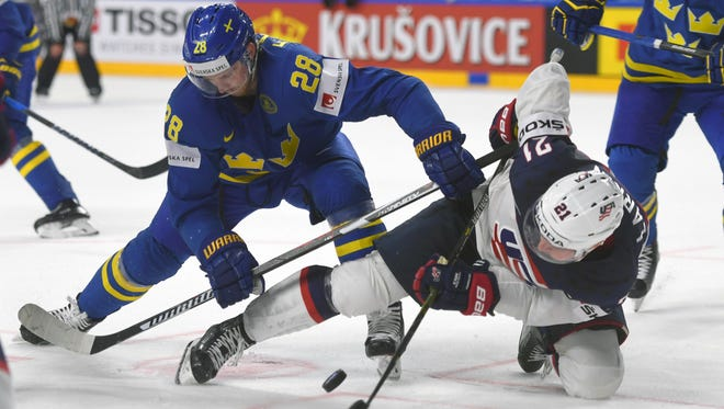 USA forward Dylan Larkin and Sweden´s Elias Lindholm vie for the puck during the World Championship tournament game in Cologne, Germany, on May 8, 2017.