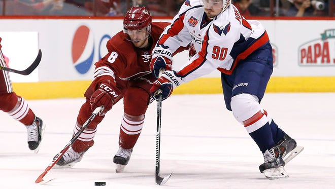 Washington Capitals' Marcus Johansson (right) battles the Arizona Coyotes' Tobias Rieder for the puck during the first period on Tuesday, Nov. 18, 2014, in Glendale.