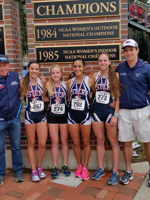 Estero poses after its national best 4 x 800-meter time at the FSU Relays on Friday: Head coach Jeff Sommer, left,  Daley Cline, Meg Slater, Meg Giovanniello, Bree Salcedo, assistant coach Ben Pignatone.