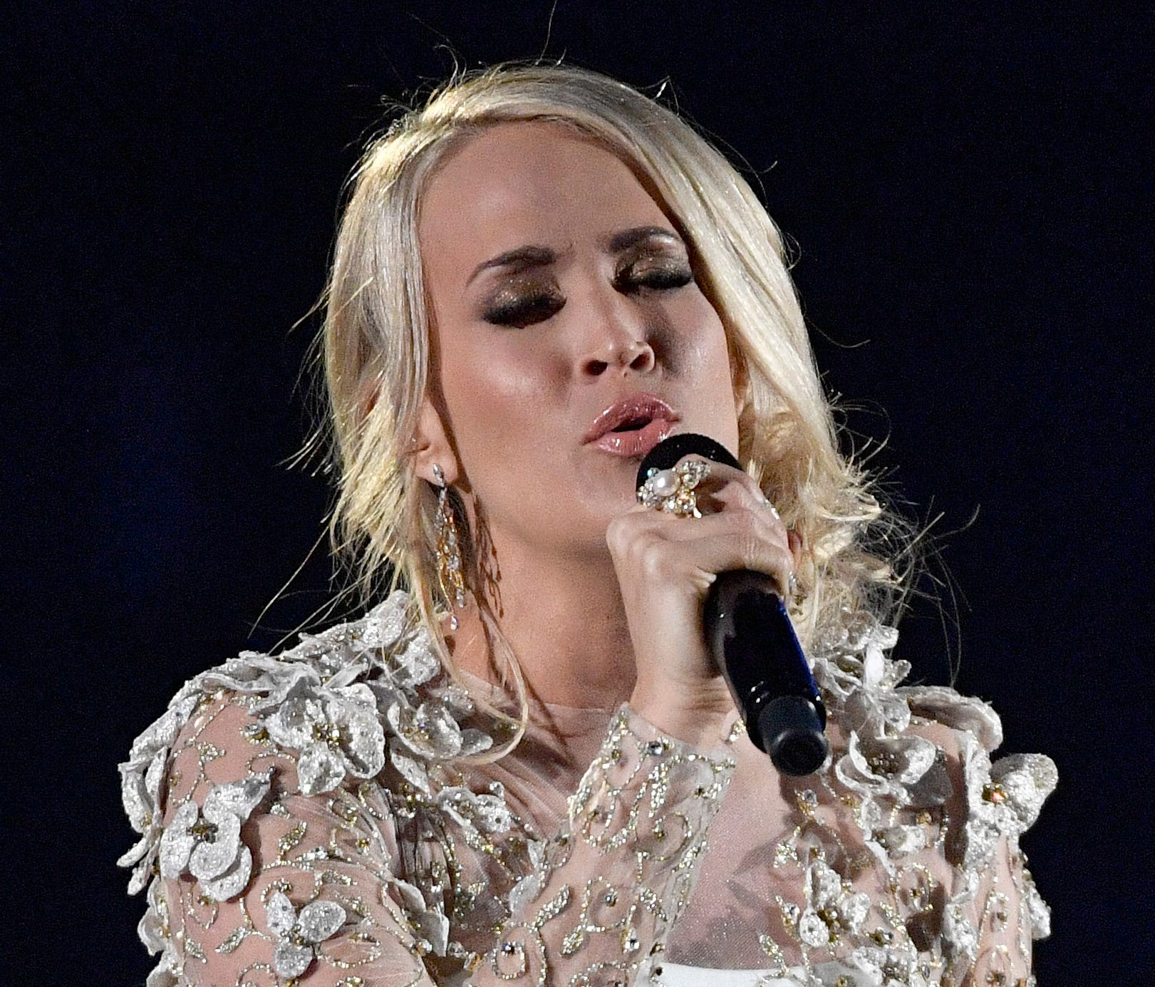 Super Bowl song 'The Champion' features vocals by country singer Carrie Underwood and hip hop artist Ludacris.