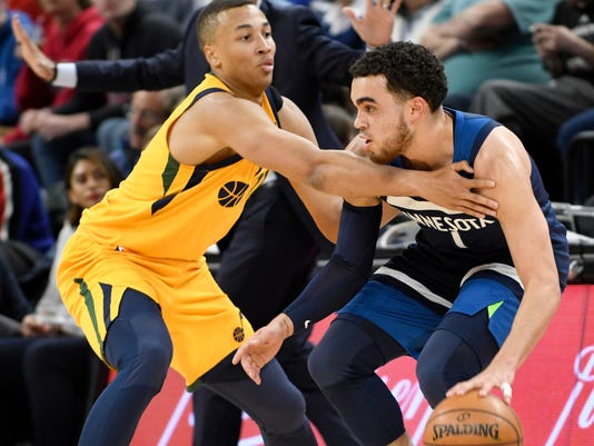 Utah Jazz's Dante Exum, left, defends against  Minnesota Timberwolves' Tyus Jones during the first quarter of an NBA basketball game Sunday, April 1, 2018, in Minneapolis. (AP Photo/Tom Olmscheid)