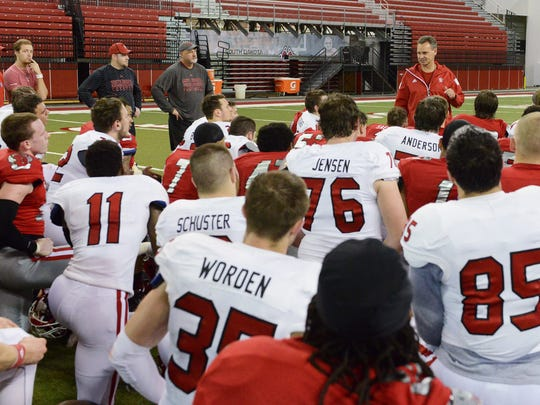 Bob Nielson addresses USD players before the 2016 spring game in Vermillion. The coach has compiled an overall record of 198–92–1.