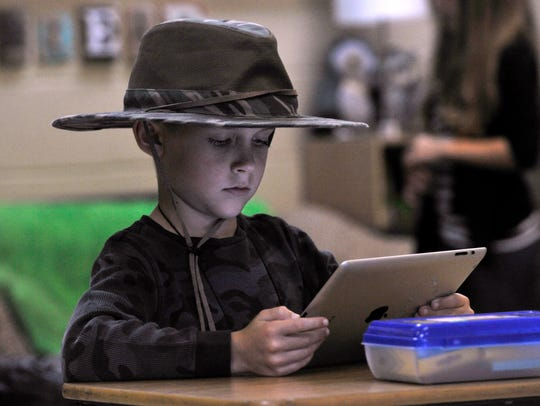 Noah Buford, 8, practices his reading in his second-grade class at Abilene Christian School on Tuesday. Noah was dressed as an African safari tourist. Tuesday was not just Halloween at ACS, it was Tourist Day for Homecoming Week.