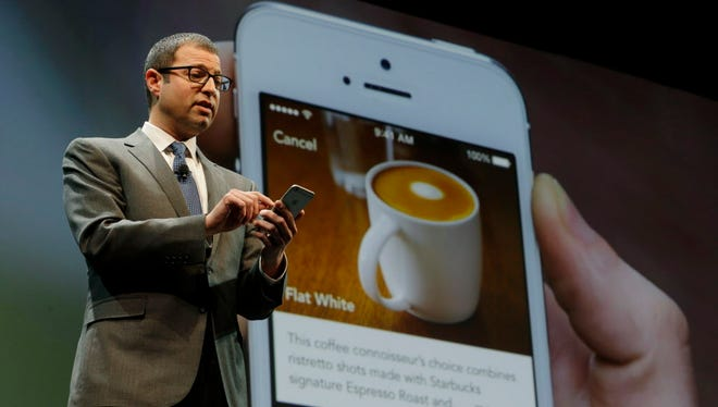 Adam Brotman, Starbucks chief digital officer, talks about the company's new mobile ordering app on March 18, 2015, at Starbucks Coffee Company's annual shareholders meeting in Seattle. The company announced on Tuesday that customers can now order and pay for their drinks ahead of time at 4,000 locations nationwide.