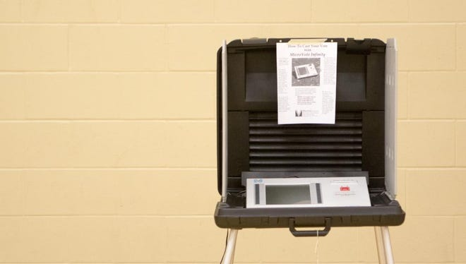A voting machine awaits the next voter at Southside Middle School during the May 2015 primary.